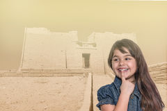 Smiling little girl is standing in front of Temple of Kalabsha Stock Photo