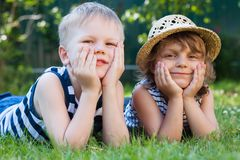 Smiling little girl in a straw hat and a boy, summertime vacation Stock Photo