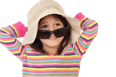 Smiling little girl in straw and sunglasses Stock Photography