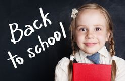 Smiling little girl student. Back to school banner. Background stock photography