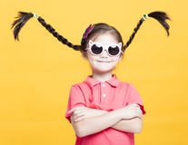 Smiling little girl with sunglasses Royalty Free Stock Image