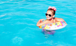 Smiling little girl in swimming pool Stock Images