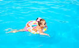Smiling little girl in swimming pool Royalty Free Stock Photo