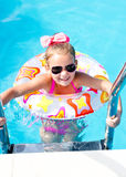 Smiling little girl in swimming pool Stock Photos
