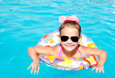 Smiling little girl in swimming pool Royalty Free Stock Photos