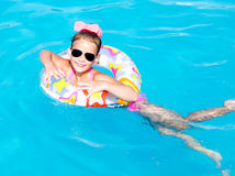 Smiling little girl in swimming pool Stock Image