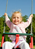 Smiling little girl on swing Royalty Free Stock Photography