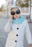 Smiling little girl in talking on cell phone Stock Images