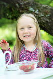 Smiling little girl at a tea party. Stock Images