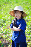 Smiling little girl in thai's farmer dress Royalty Free Stock Image