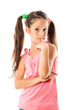 Smiling little girl thinking about Royalty Free Stock Images