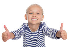 Smiling little girl with thumbs up. Happy smiling little girl with thumbs up gesture, isolated on white background. Girl is six years old Stock Photo