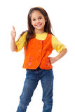 Smiling little girl with thumbs up sign Stock Photos