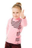 Smiling little girl with thumbs up sign Stock Image