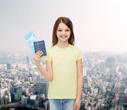 Smiling little girl with ticket and passport Royalty Free Stock Images