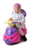 Smiling little girl on toy car Royalty Free Stock Images