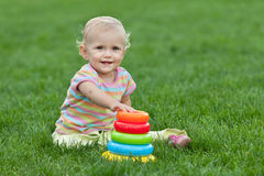 Smiling little girl with a toy pyramid Stock Image