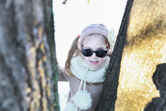 A smiling little girl between two trees Stock Photography