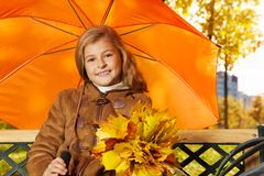 Smiling little girl with umbrella Stock Photography