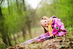 Smiling little girl with umbrella in the park Royalty Free Stock Photo