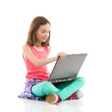 Smiling little girl using a laptop Stock Photos