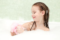 Smiling little girl washing in bath Royalty Free Stock Photos