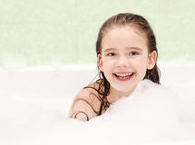 Smiling little girl washing in bath Royalty Free Stock Images