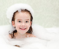 Smiling little girl washing in bath Royalty Free Stock Photo