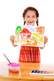 Smiling little girl with watercolor painting Stock Image