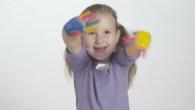 Smiling little girl waving with painted hands stock video