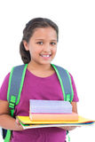 Smiling little girl wearing book bag and holding her homework Stock Photos