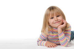 Smiling little girl on the white Royalty Free Stock Images