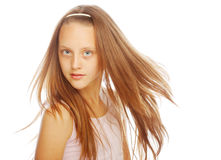 Smiling little girl on white background in studio stock photos