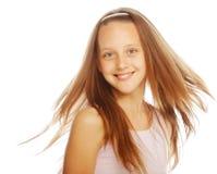 Smiling little girl on white background in studio stock photo