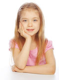 Smiling little girl on white background in studio royalty free stock images