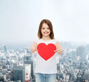 Smiling little girl in white blank t-shirt Stock Photos