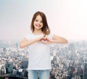 Smiling little girl in white blank t-shirt Stock Photography