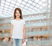 Smiling little girl in white blank t-shirt Stock Photography