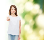 Smiling little girl in white blank t-shirt Royalty Free Stock Photos