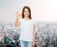 Smiling little girl in white blank t-shirt Stock Images