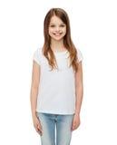 Smiling little girl in white blank t-shirt Stock Image