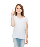 Smiling little girl in white blank t-shirt royalty free stock image