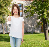 Smiling little girl in white blank t-shirt Royalty Free Stock Images