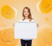 Smiling little girl with white board Royalty Free Stock Images