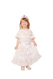 Smiling little girl in a white dress and a crown. Royalty Free Stock Photos
