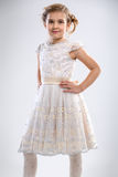 Smiling little girl in white dress Stock Photography