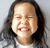 Smiling little girl with wide mouth open Royalty Free Stock Photos