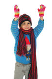 Smiling little girl with winter clothes Stock Photos