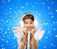 Smiling little girl in winter clothes Stock Photo