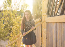Smiling little girl on wooden porch Royalty Free Stock Photo